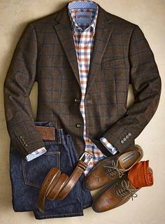 Plaid jacket, brown wing tips, love the mix of patterns and orange accents