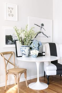 white tulip table with bistro hair and reupholstered wingback