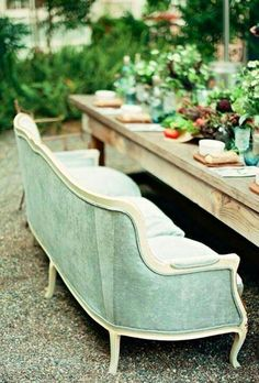 Sofa for dining and love the table & tabletop decor!