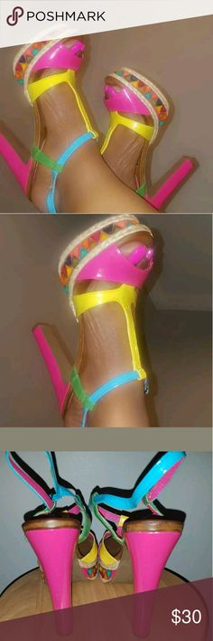 Multi Colored  Heels Pictures speak  for themselves... still  in great condition. Worn  only once Shoes Sandals