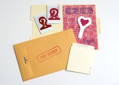 Host a Valentine detective party for your guests to solve clues leading to their secret admirers. Download and print secret decoder invitations and more.