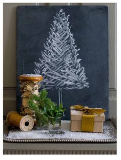 I love this little chalkboard Christmas tree! I think I could make that. I'd just have to figure out how to make the chalkboard.