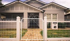 Beautiful example of a woven wire loop fence with a historic look paired with a 1920s bungalow.