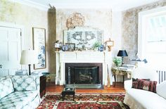Traditional and timeless living space with patterned sofa and fireplace