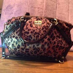 """Coach Limited Edition Ocelot Madison Leopard Print Preowned mint condition. Gorgeous.  3.5 Deep 14"""" length, height 10"""" strap drop 4 1/2  12 With paten leather straps. Coach Bags"""