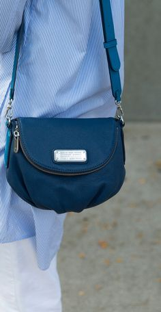 A great shoulder bag that can be also worn as a cross-body featuring a magnetic snap and zipper flap.