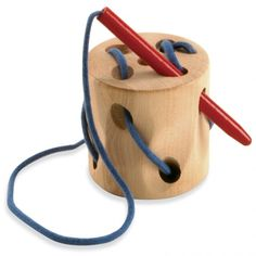 """Stitching Block:The wooden """"needle"""" threads smoothly in and out of the holes of this handmade wooden block. Children can retrace the pattern back out with the needle and do the activity again.   Encourages hand-eye coordination, concentration, and pattern design. The """"thread"""" (cord) is fastened securely to the wood block and the needle — no parts to lose! 2½"""" base x 2½"""" high. Dr. Toy Best Classic Toy Award. Ages 3 - 6."""
