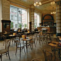 A flock of Thonet chairs at the Kavarna Imperial (Cafe Imperial) in Prague, perhaps the most famous of Prague's coffee houses. The chairs are still in production in Czechoslovakia by TON. First produced by Michael Thonet in 1861