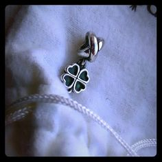 Pandora charm Original four leaf clover dangle charm, sterling silver and green enamel. Excellent condition, fits all Pandora bracelets except essence, no trades, no pay pal Pandora Jewelry Bracelets