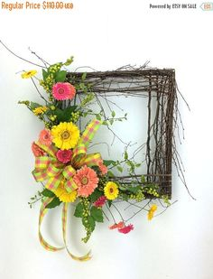 Rustic Square Spring wreath made with vibrant Gerber Daisies and multicolored bow. This garden wreath will look amazing hanging on your door