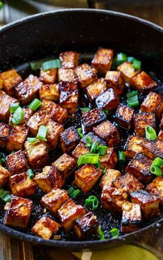 Asian Garlic Tofu- marinated in a sweet and spicy sauce and seared until crispy. #veganDishes