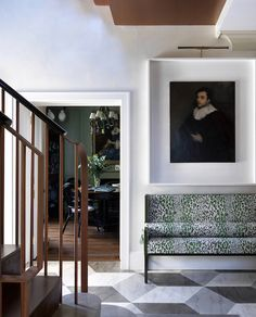 For this West London townhouse, Beata Heuman wanted to create a striking, imaginative and colorful space that felt current. The firm designed the bench, which is upholstered in a Rose Cummings fabric. The floor and walls have bespoke paint finishes.