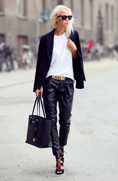 Pair a boyfriend tshirt and blazer with leather pants and a statement belt... You can't beat this for a neat monochrome look. Credit: lamodellamafia.com