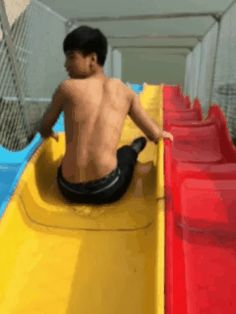Chinese Dude not doing so well on a Water slide