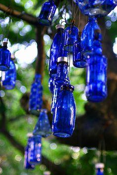 Blue Bottles by jasperparnevik, via Flickr Glass Garden Art, Bottle Garden, Diy Bottle, Blue Bottle, Wine Bottle Crafts, Bottle Art, Glass Art, Reuse Bottles, Bottles And Jars