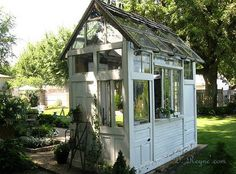 up-cycled doors & windows....love to do this and make it a playhouse for Grandkids