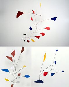 calder mobile sculptures. my grandparents had one of these in their living room when i was a kid.  reminds me of whimsical summers of staying at their house.