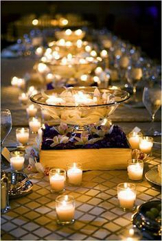 Have a small budget for wedding centerpieces? Use clusters of candles - the tables will glow and guests won't miss the flowers