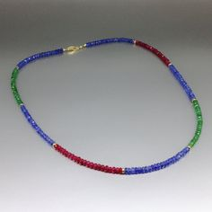 Check out Stunning necklace blue Sapphire, Ruby and Emerald enhanced with 14K gold parts and clasp - gift idea on gemorydesign