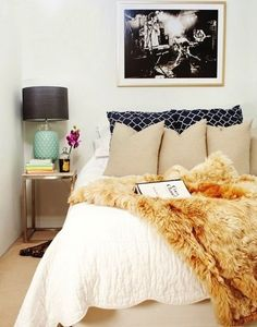 Small bedroom design - I'm so in love with this. Fur, rock n' roll art, retro touches and natural colors. This is so me!