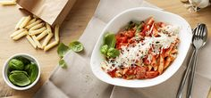 PENNE SALSICCIA E POMODORO BY VAPIANO Home-made penne with spicy salsiccia, cherry tomatoes, garlic and spring onions in our home-made tomato sauce with basil. / Jan/Feb 2015