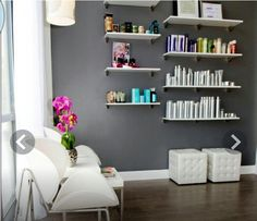 Reception Area... bright shelves and products on a charcoal wall. So bright and fresh. Makes the product look kind of like art