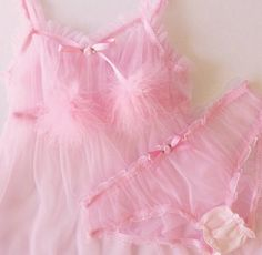 Get ready to look like a complete dream in this adorable Pink Ruffle Babydoll! It is made from a sheer nylon chiffon and adorned with ruffles at the hem, bust and straps. It is short, playful and perfect for lounging around by yourself or a sleepover with your best girls!   It has elastic at the top, under bust and straps for a nice, comfortable fit. It is topped with candy pink satin bows and matching roses at the hem and center front. ** Babydoll and Panty are SHEER!  **Optional marabou…
