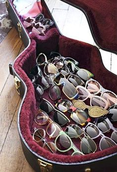 Sunglasses displayed in an old guitar case, Elissa Cannelle Castelbou, photo by Yann Deret
