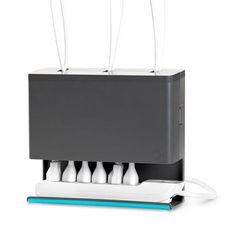Plug Hub Cord Manager This holds extra lengths of cords too! Store on floor or wall.