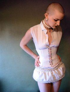 DIY Corset with plastic boning. Oookay. She's bald. But cool corset!