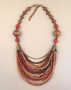 Multi-strand terra cotta and copper statement necklace. Handcrafted, one-of-a-kind.