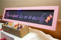 Love is sweet and so is candy. A nice chalkboard for a candy buffet table.