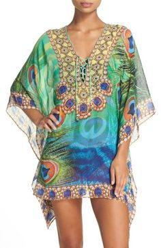 Free shipping and returns on Asa Kaftans Kashmir Short Kaftan at Nordstrom.com. Faceted crystals twinkle and shine at the neckline of a gauzy, flowing kaftan laced up the front with beaded cords. Vibrant mixed patterns make the look a breezy and glamorous option anywhere from the ocean to the open-air market.