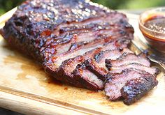 """Hickory Smoked Beef Brisket~Have you ever wanted to start a grill in the morning?  Do you ever think or say """"Yeah, I find the idea of devoting most of a day to tending to hickory logs and smelling like smoke appealing""""?  Smoking your own beef brisket is not a choice.  It is a lifestyle, at least for a day!!"""