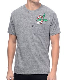 Add a seasonal piece of gear to your wardrobe with the RipNDip Candy Cane Lord Nermal Heather Grey Pocket T-Shirt. This shirt is designed with the sassy Lord Nermal grasping a candy cane emerging from the front left chest pocket and when the pocket is low