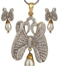 Shop American diamond jewellery online for women at best discounted prices from our unique design collection of American jewelry sets including necklaces, pendants & earrings. American Diamond Jewellery, American Jewelry, Diamond Jewelry, Bridal Jewellery Sets Online, Bridal Jewelry Sets, Butterfly Earrings, Butterfly Pendant, Pendant Design, Pendant Set