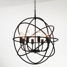 This 8 Light Chandelier has a Dark brown finish from the Bird Cage family.