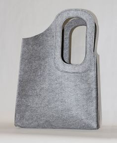 Grey felt bag with asymmetrical handle by JaneClarbour