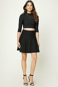 A mini skater skirt featuring a high waist and a flared hem.