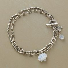 """Rainbow moonstones, faceted and smooth, are droplets of iridescence at the wrist. Sterling silver links and Thai silver beads join with a toggle clasp. Handcrafted Sundance exclusive. Approx. 7-1/4""""L."""