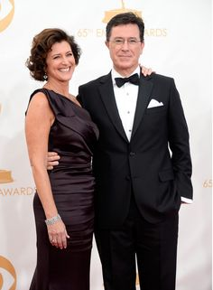 #emmyfashion Actor Stephen Colbert and his wife Evelyn Colbert (R) arrive at the 65th Annual Primetime Emmy Awards held at Nokia Theatre L.A. Live on September 22, 2013 in Los Angeles, California.