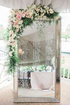 mirror wedding seating chart ideas with floral decorated #weddingideas #weddingdecor #weddingreception #weddingseatingplan #weddinginspiration