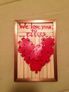 DIY Valentine's gift. great craft for kids to make for mom or dad. Glue Popsicle sticks to frame insert, then use a hot glue gun to make a heart shape (paint back sides of puzzle pieces and let dry prior to this). Then write cute message.