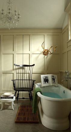 Inspiration from Bathrooms.com: Want to give your bathroom a Georgian appeal with a contemporary twist? Paint panelling in a pale colour and paint furniture in a dark shade to create a monochromatic contrast. #ensuitebathrooms #bathrooms #chandelier