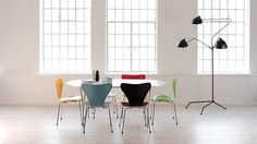 Can't tell they're replicas! AJ series 7 chairs and Mouille R3-MFL lamp