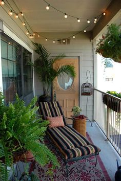 """Balcony bliss  """"This was a third story apartment in Austin and the balcony measured 150 square feet. Every single inch of space was utilized, proving that you don't have to have a large space to have a great garden. Vertical plantings, lots of seating — bistro set, chaise lounge and a bench — cozy outdoor rugs, overhead party lights and warm accessories make it a true outdoor roomOutdoor spaces - Slideshows and Picture Stories - TODAY.com"""