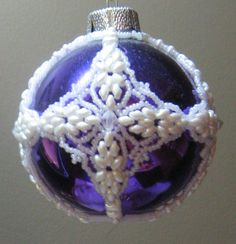 The globe used with this original design is vintage mercury glass. Original design by Mary Ballou.