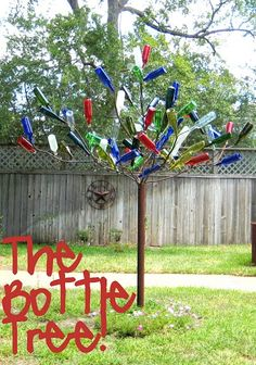 This looks like my bottle tree on steroids. The V Spot: DIY Wine Bottle Crafts Wine Tree, Wine Bottle Trees, Empty Wine Bottles, Wine Bottle Corks, Bottles And Jars, Bottle Cap Crafts, Diy Bottle, Bottle Garden, Tree Crafts