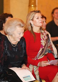 Queen Maxima rocked a red pencil dress as she celebrated the 15th anniversary of the Prince Claus Leerstoel at Noordeinde Palace on Thursday (seen sitting alongside mother-in-law Princess Beatrix of the Netherlands)