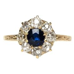Victorian Sapphire and Diamond Halo Engagement Ring | From a unique collection of vintage engagement rings at http://www.1stdibs.com/jewelry/rings/engagement-rings/ #UniqueEngagementRings #haloring #halorings